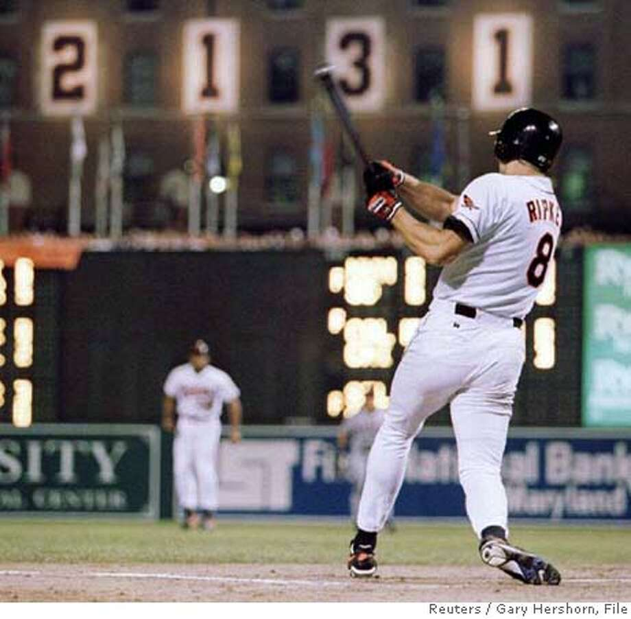 Baltimore Orioles Cal Ripken Jr. hits a base hit in the eighth inning of his 2,131st consecutive game, in Baltimore, Maryland in this September. 6, 1995 file photo. Ripken, a 19-time All-Star with more than 3,000 hits, will be officially enshrined in the National Baseball Hall of Fame on July 29, 2007. REUTERS/Gary Hershorn/Files (UNITED STATES) Photo: GARY HERSHORN