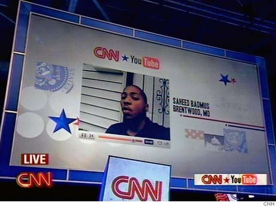 YouTube contributor Saheed Badmus poses a question to the Democratic presidential candidates at the Citadel. Photo courtesy of CNN