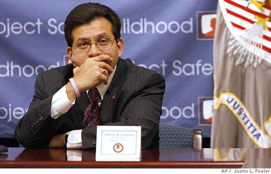 Attorney General Alberto Gonzales listens as local law enforcement speak on their efforts to combat sexual abuse and exploitation of children, during a roundtable discussion of local Project Safe Childhood partners, including U.S. Attorney Rodger A. Heaton of the Central District of Illinois, at the U.S. Attorneys office in Springfield Ill., Friday, July 27, 2007. (AP Photo/The State Journal-Register, Justin L. Fowler) Photo: Justin L. Fowler