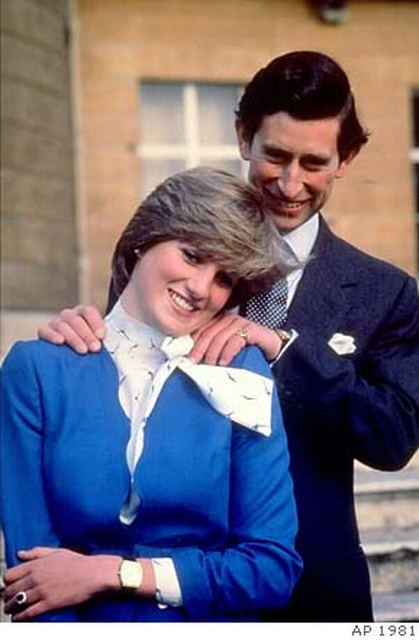 FILE--Britain's Prince Charles and Princess Diana pose on the grounds of Buckingham Palace after announcing their engagement in this Feb. 24, 1981, file photo. Princess Diana was seriously Aug. 30, 1997 was seriously injured and her companion Dodi Fayed, killed in a car crash early Sunday as they were being chased by photographers, police said. (AP Photo) A Feb. 24, 1981 file photo Photo: Xx