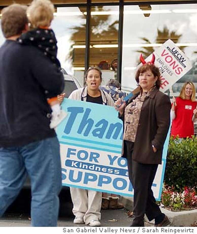 Health care fight / Insurance at center of grocery strikes