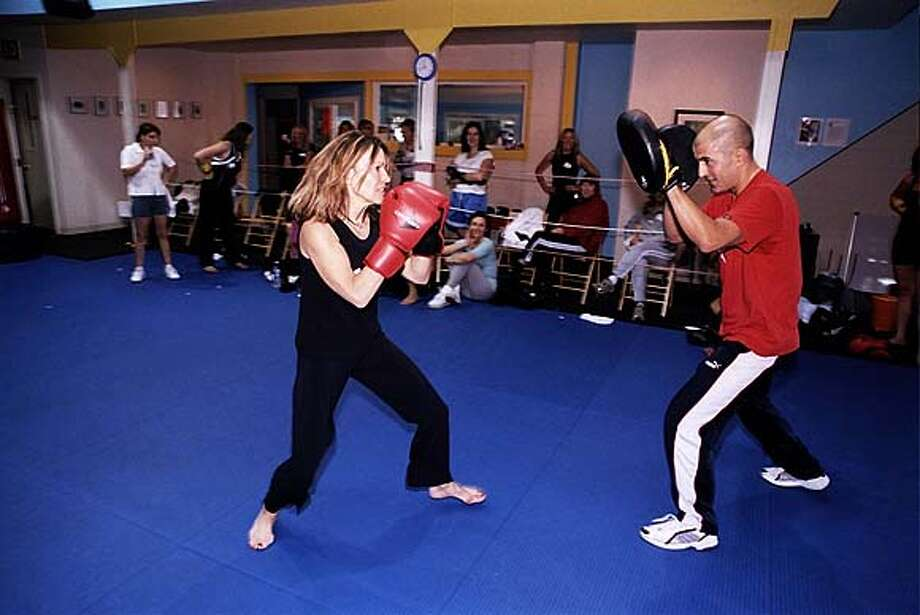 / Datebook for SOCIAL05; Catherine Debs pulls no punches when hosting a party: she treated friends to boxing lessons and lunch on Halloween. Thomas J. Gibbons / Special To The Chronicle Photo: Thomas J. Gibbons