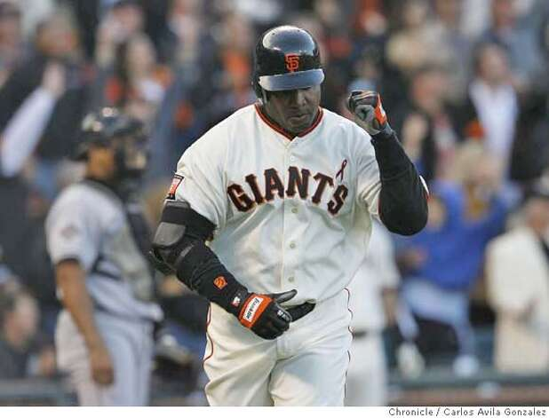 Barry Bonds pumps his fist after hitting home run number 754 in the bottom of the first inning off of Marlins starter Rick Vanden Hurk. Florida Marlins play the San Francisco Giants at AT&T Park in San Francisco, CA, on Friday, July, 27 2007. photo taken: 07/27/2007  Carlos Avila Gonzalez / The Chronicle ** (cq) Photo: Carlos Avila Gonzalez