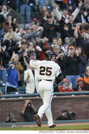 Barry Bonds points to the crowd after scoring on home run number 754 in the bottom of the first inning off of Marlins starter Rick Vanden Hurk.  Florida Marlins play the San Francisco Giants at AT&T Park in San Francisco, CA, on Friday, July, 27 2007. photo taken: 07/27/2007  Carlos Avila Gonzalez / The Chronicle ** (cq) Photo: Carlos Avila Gonzalez