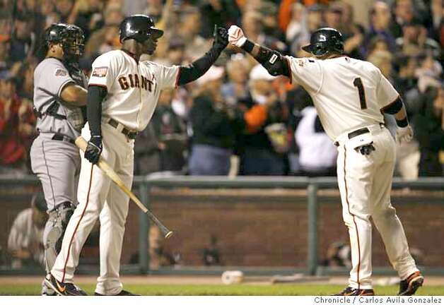 Giants center fielder Fred Lewis congratulates Bengie Molina after Molina hit a solo home run in the bottom of the fifth inning to tie the game. Florida Marlins play the San Francisco Giants at AT&T Park in San Francisco, CA, on Friday, July, 27 2007. photo taken: 07/27/2007  Carlos Avila Gonzalez / The Chronicle ** (cq) Photo: Carlos Avila Gonzalez