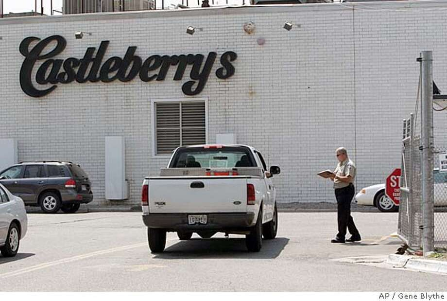 A pickup truck is checked by security at the entrance to the Castleberry's Food plant in Augusta, Ga., Tuesday, July 24, 2007. The plant has temporarily shut down after it was linked to botulism in canned chili. (AP Photo/Gene Blythe) Photo: Gene Blythe