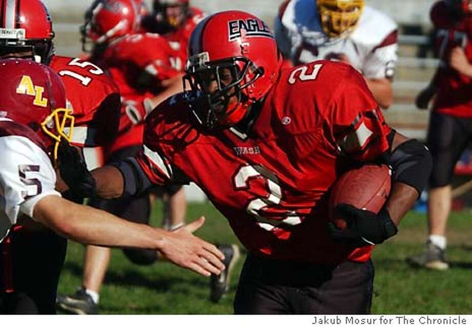 Tyrell Jones, of Washington High School, runs the ball in the first quarter of the game against Lincoln High at a match in Washington High School in San Francisco on Friday Oct. 24, 2003.  Event on 10/24/03 in San Francisco. JAKUB MOSUR / The Chronicle Photo: JAKUB MOSUR