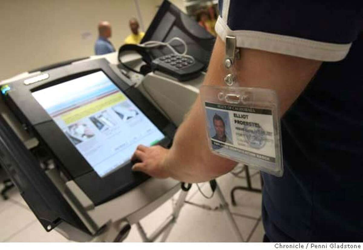 MACHINES03_113_PG.JPG During a tour of voting machines in the area where researchers try to thwart security, employee Elliot Proebstel starts up a voting machine being tested. California Secretary of State Debra Bowen gave a tour of the room where a team of academics, hackers and researchers will test every kind of voting machine that is being considered for use by counties in Califorinia elections in 2008. The tour is part of a extraordinary effort by Bowen -- who is being over backwards -- to assure voters that there won't be any elections