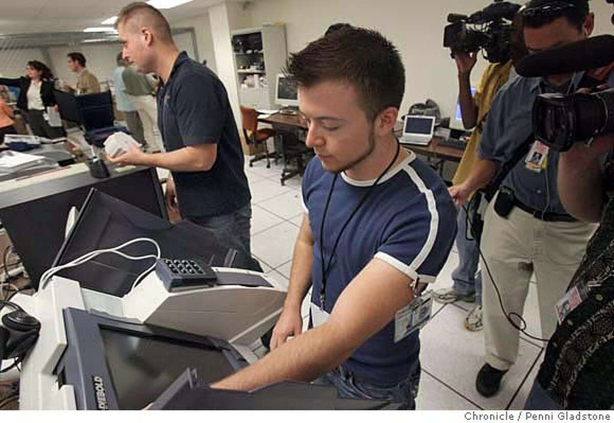MACHINES03_071_PG.JPG During a tour of voting machines in the area where researchers try to thwart security, employee Elliot Proebstel starts up a voting machine being tested. This is part of a Tour of voting machines and the area where researchers will try to thwart security. California Secretary of State Debra Bowen gave a tour of the room where a team of academics, hackers and researchers will test every kind of voting machine that is being considered for use by counties in Califorinia elections in 2008. The tour is part of a extraordinary effort by Bowen -- who is being over backwards -- to assure voters that there won't be any elections