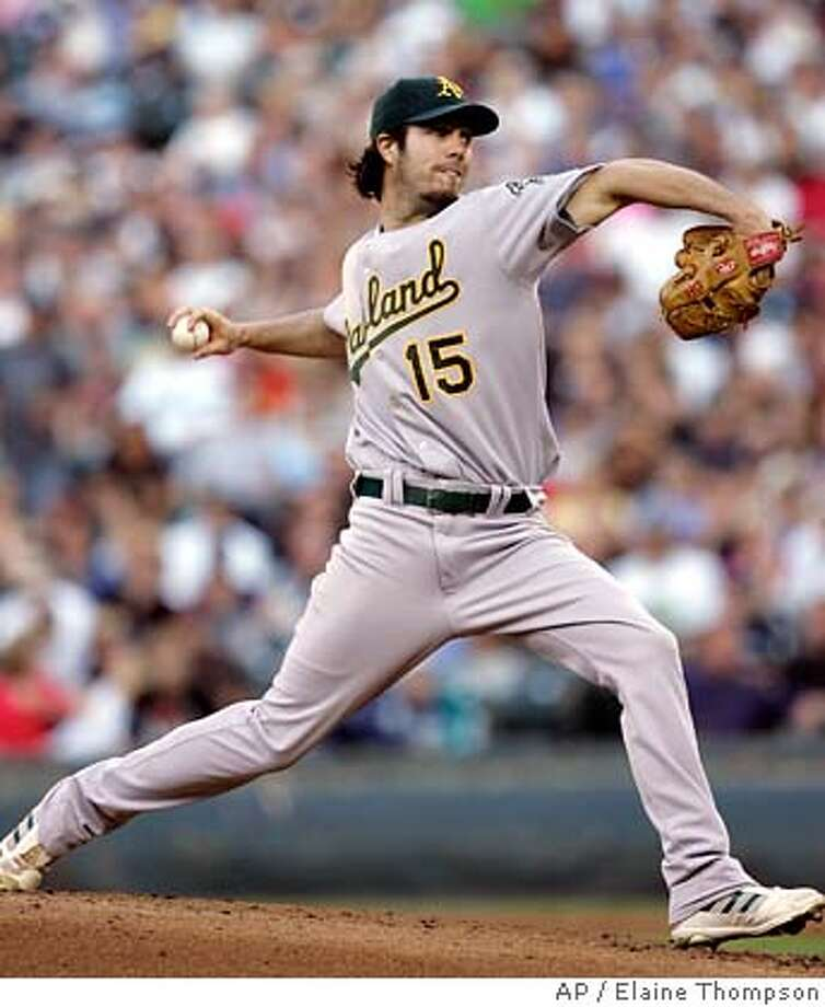 Oakland Athletics' Dan Haren throws against the Seattle Mariners in the first inning of a baseball game Thursday, July 26, 2007, in Seattle. (AP Photo/Elaine Thompson) Photo: Elaine Thompson