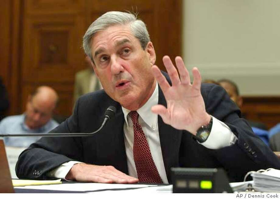 FBI Director Robert Mueller testifies on Capitol Hill in Washington, Thursday, July 26, 2007, before the House Judiciary Committee. (AP Photo/Dennis Cook) Photo: Dennis Cook