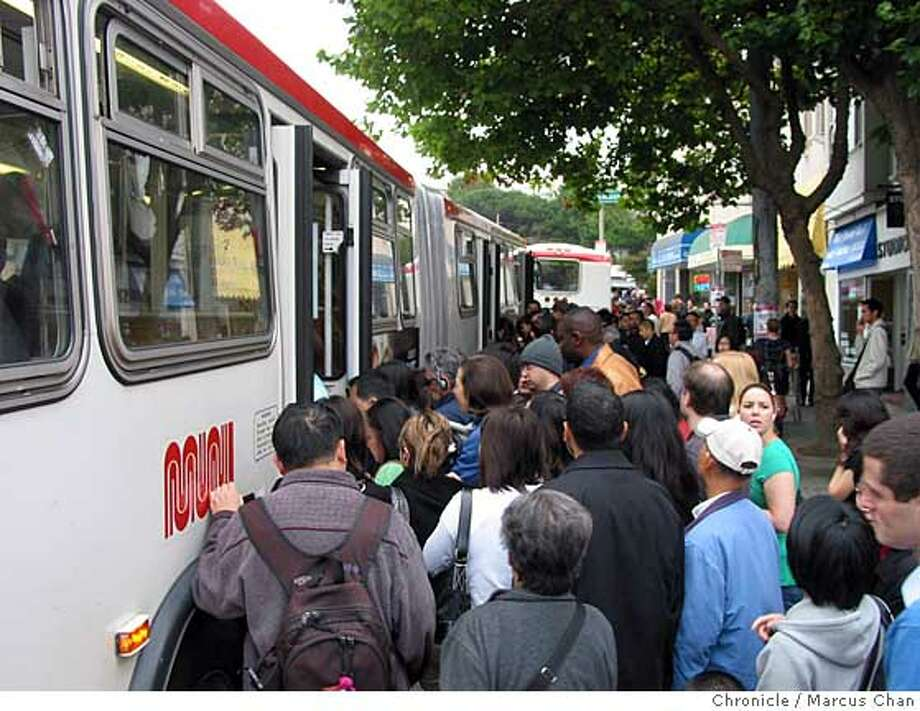 Delays on Muni's K, L and M metro lines forced morning commuters at West Portal to crowd onto shuttle buses. credit:  Marcus Chan Photo: Marcus Chan