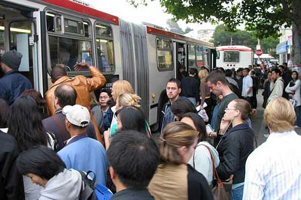 Problems with Muni's metro service forced morning commuters at West Portal to crowd onto shuttle buses Friday. credit:  Marcus Chan