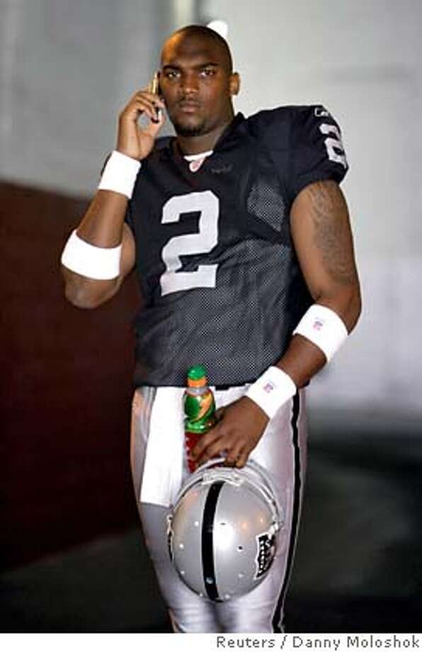 Oakland Raiders quarterback JaMarcus Russell talks on a mobile phone during the 2007 Reebok NFL Players Rookie Premiere in Los Angeles, California May 19, 2007. REUTERS/Danny Moloshok (UNITED STATES)  Ran on: 05-20-2007  Raider QB JaMarcus Russell put in an appearance at &quo;Reebok NFL Rookie Premiere.&quo;  Ran on: 05-20-2007  Raiders QB JaMarcus Russell put in an appearance at &quo;Reebok NFL Rookie Premiere.&quo; Photo: DANNY MOLOSHOK