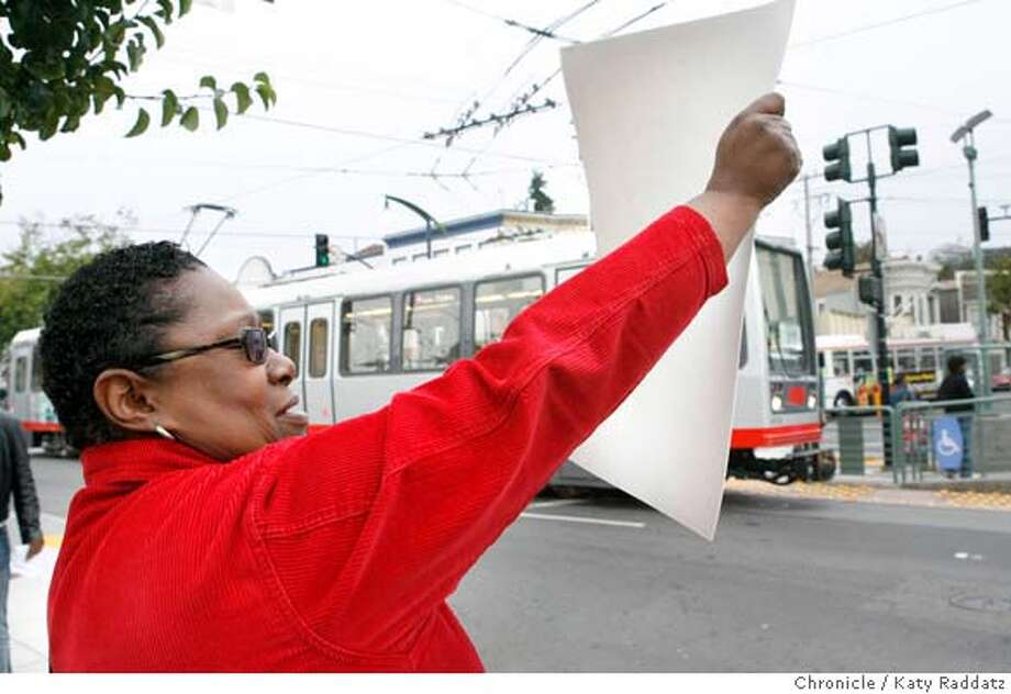 MUNI27_037_RAD.jpg  Jacqueline Phillips, a longtime Bayview resident, waves her sign and shouts to a passing T-Third streetcar. Bayview residents gather at Palou and Third Sts. in San Francisco to demand that MUNI restore the 15 line until the T-Third line becomes safe and efficient.  (Katy Raddatz/The Chronicle)  **Jacqueline Phillips Mandatory credit for the photographer and the San Francisco Chronicle. No sales; mags out. Photo: Katy Raddatz