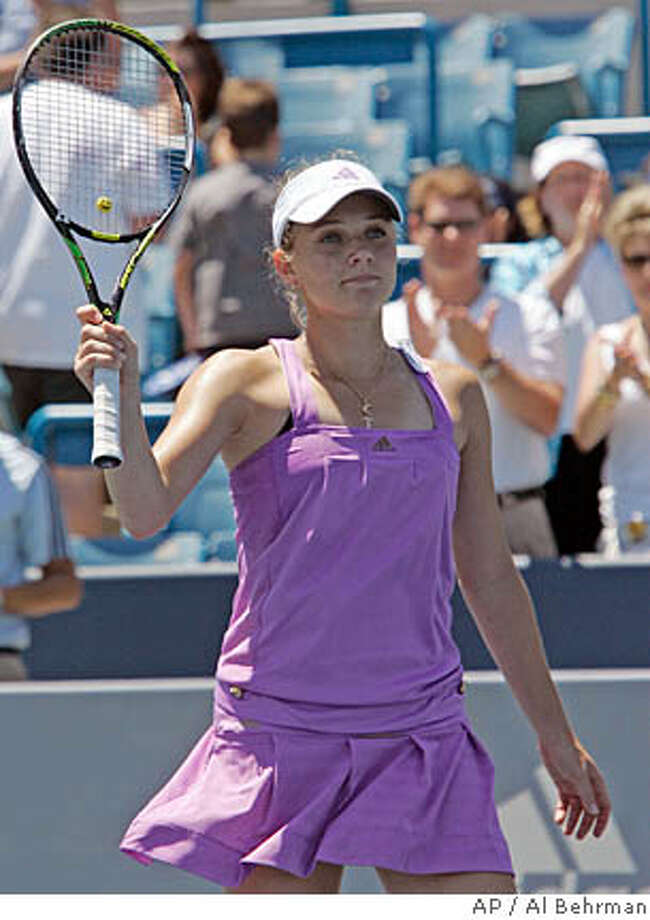 Anna Chakvetadze, from Russia, acknowledges the crowd after defeating Akiko Morigami, from Japan, 6-1, 6-3, to win the Western & Southern Financial Group Women's Open tennis tournament, Sunday, July 22, 2007, in Mason, Ohio. (AP Photo/Al Behrman) Photo: Al Behrman