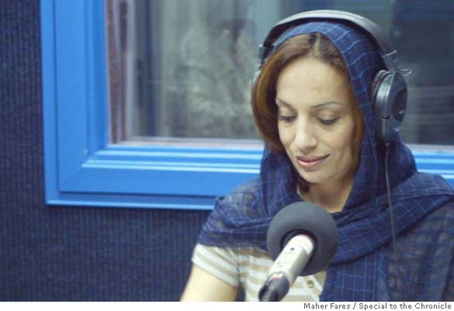 Radio personality Maisoun Manasreh hosts a morning breakfast show from the West Bank town of Ramallah. She considers herself a secular Muslim, but wears a scarf during the twice-weekly religious program with Sheikh Saleh Naytan.  Photo by Maher Fares/ Special to TheChron.  Ran on: 07-27-2007  Maisoun Manasreh hosts a morning radio show from the West Bank town of Ramallah.  Ran on: 07-27-2007 Photo: Charmaine Seitz