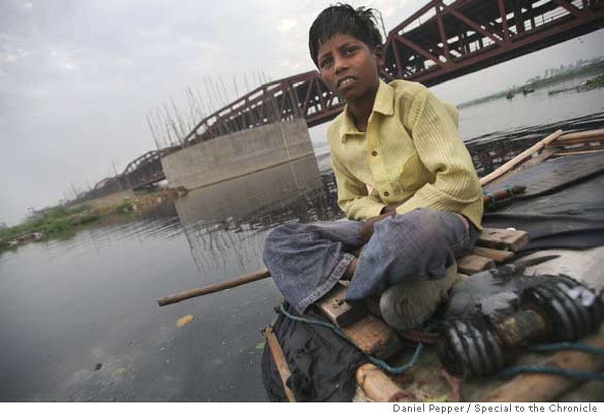 Somnath Dantoso, who is the subject of the lead of the story. special to the chronicle Daniel Pepper Ran on: 07-27-2007 Somnath Dantoso, 12, uses a magnet to fish coins out of the polluted Yamuna River in New Delhi. Commuters toss them in for luck. Ran on: 07-27-2007