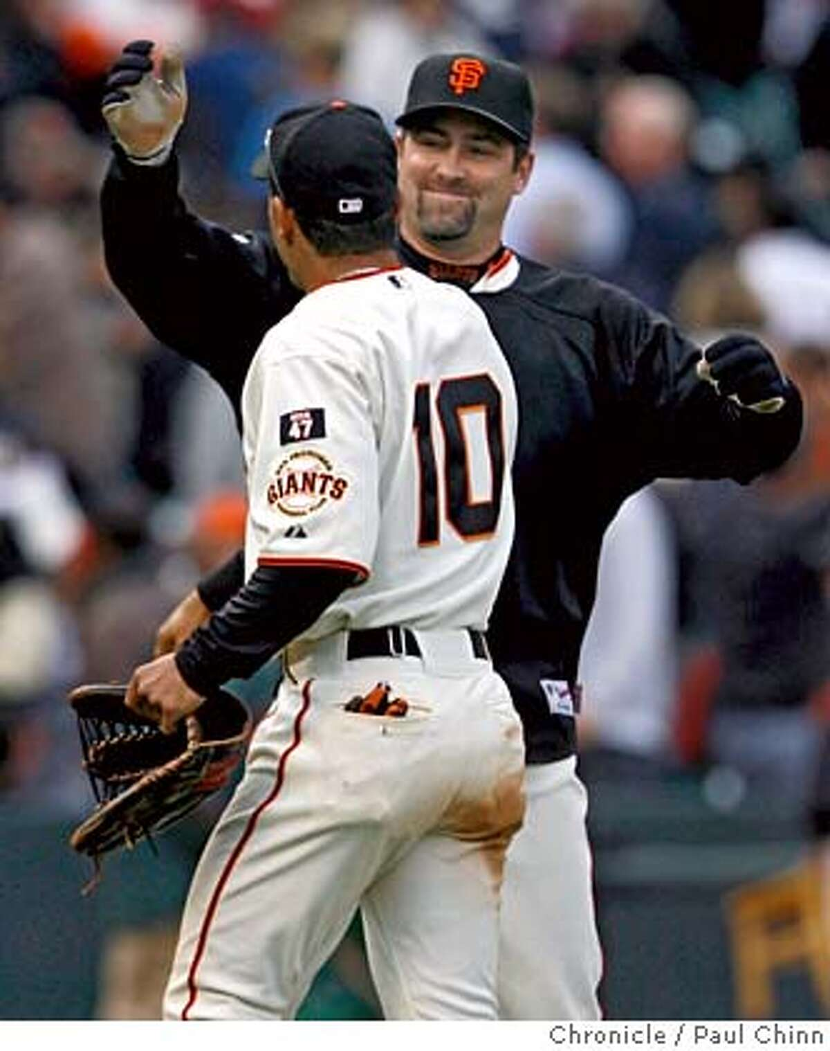 Rich Aurilia is about to embrace Dave Roberts on his 3 for 5, 2 RBI game in this file photo from July 26, 2007. The former Giants players are meeting on the field again at a 2016 Giants-Dodgers exhibition, with Aurilia as guest coach with the Giants training camp and Roberts as a Dodgers manager.