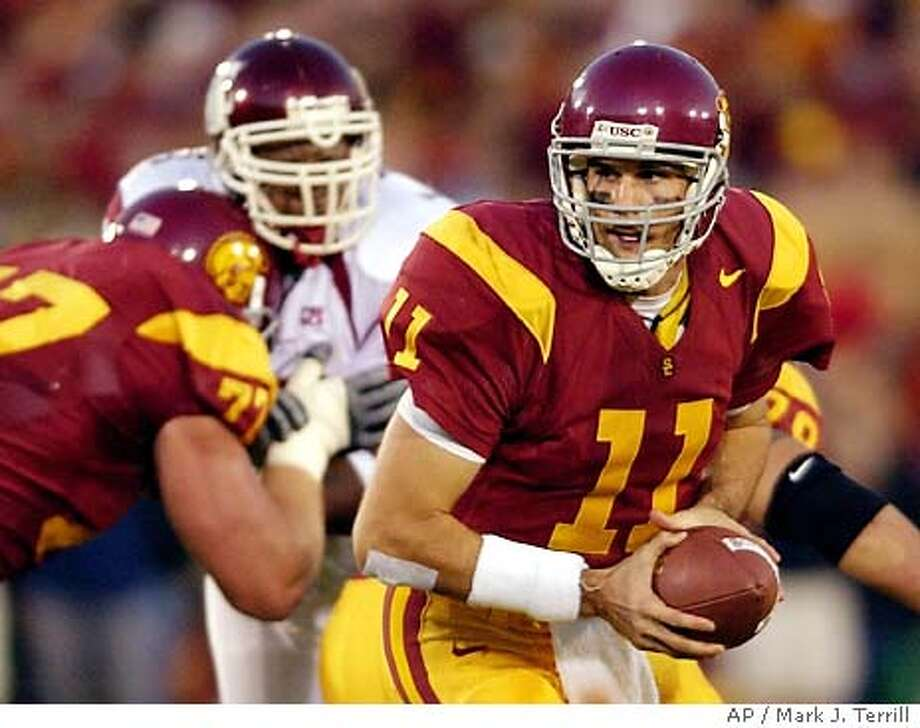 University of Southern California quarterback Matt Leinart gets set to hand off the ball during the first half against Washington State, Saturday night, Nov.1, 2003, in Los Angeles. USC won the game 43-16. (AP Photo/Mark J. Terrill) Photo: MARK J. TERRILL
