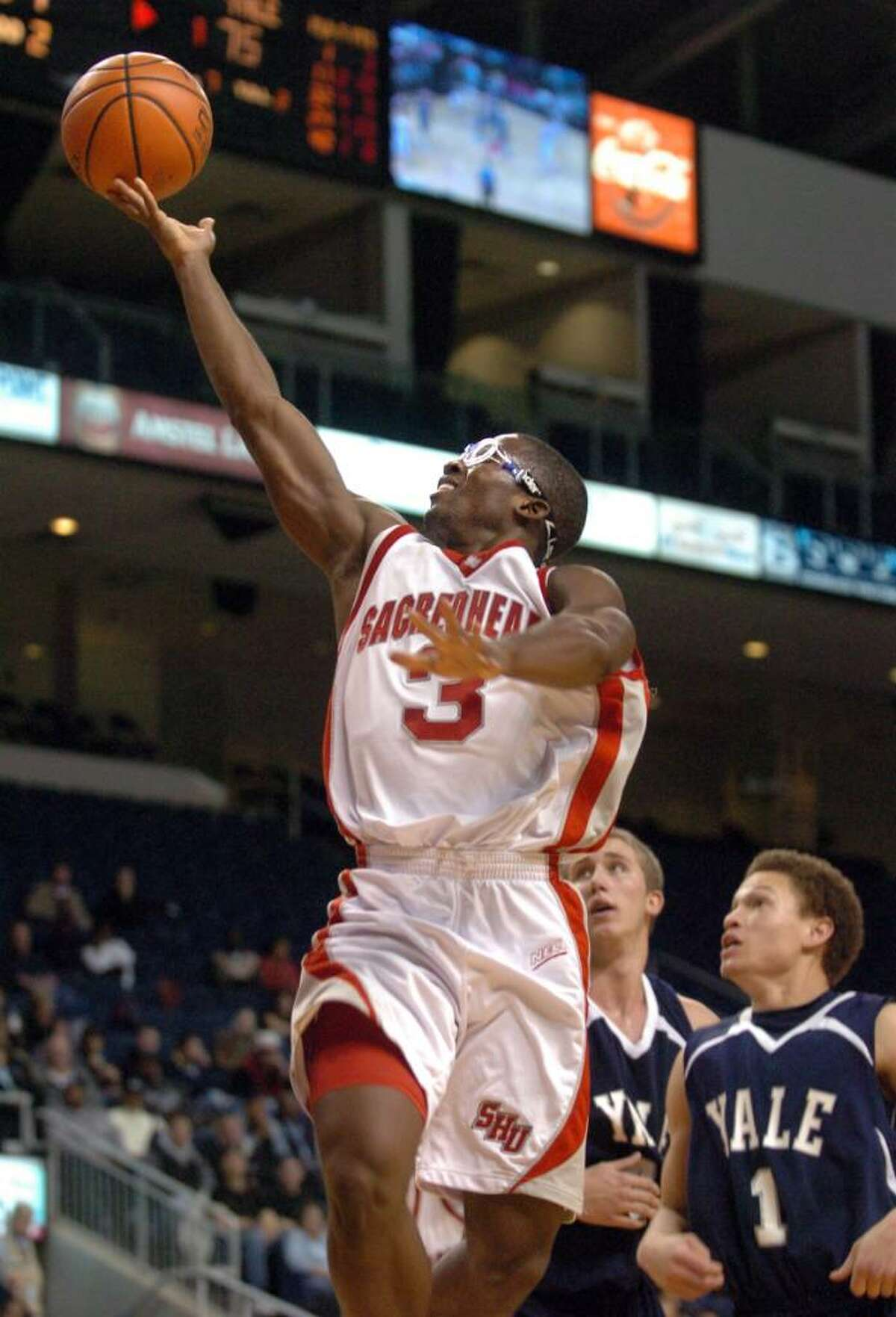 Sacred Heart's Jerrell Thompson lays up the ball during the second half of Friday night's Connecticut 6 classic game against Yale at the Arena at Harbor Yard.