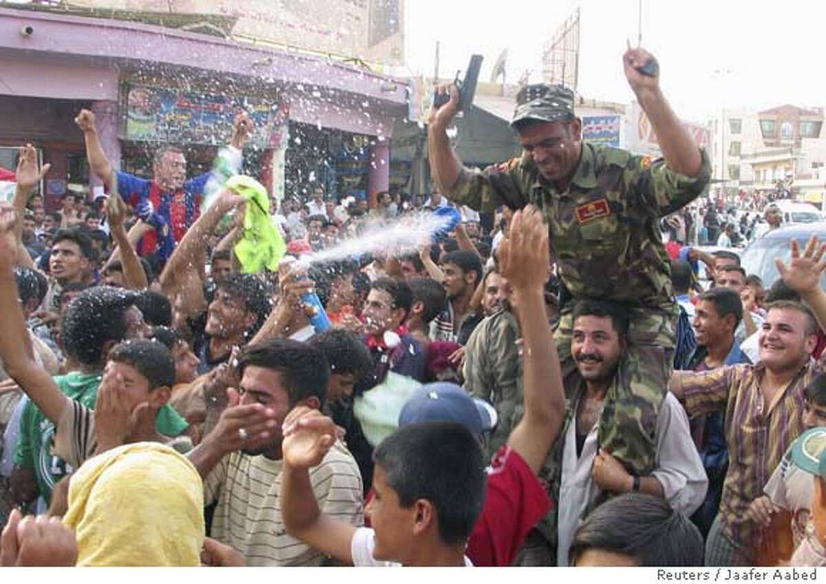 Residents celebrate the victory of Iraq's soccer team over South Korea during the semi-final of the 2007 AFC Asian Cup soccer tournament, in Kut, 172 km (107 miles) south of Baghdad, July 25, 2007. REUTERS/Jaafer Aabed (IRAQ) 0