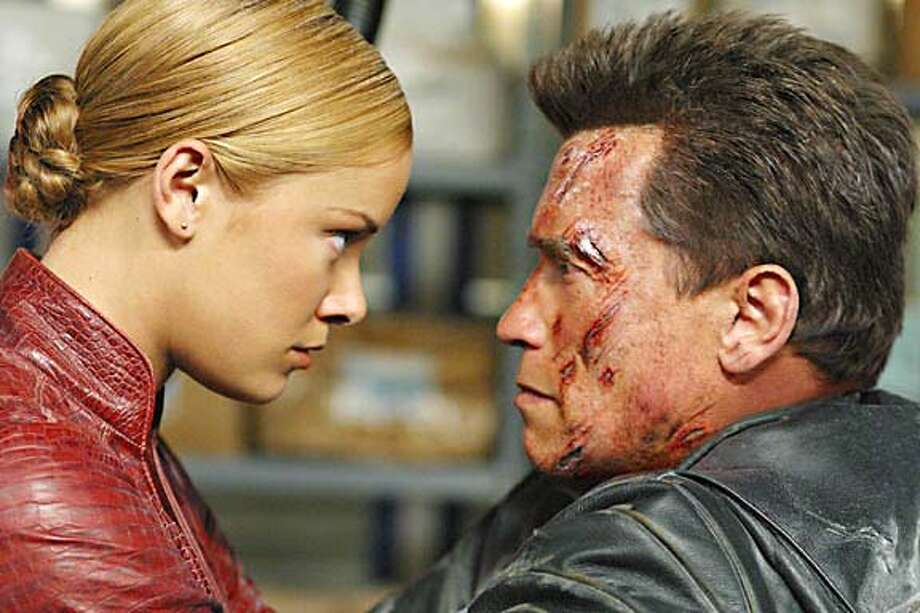 "Terminators played by Krisanna Loken and Arnold Schwarzenegger face off in ""Terminator 3: Rise of the Machines."" Photo: HO"