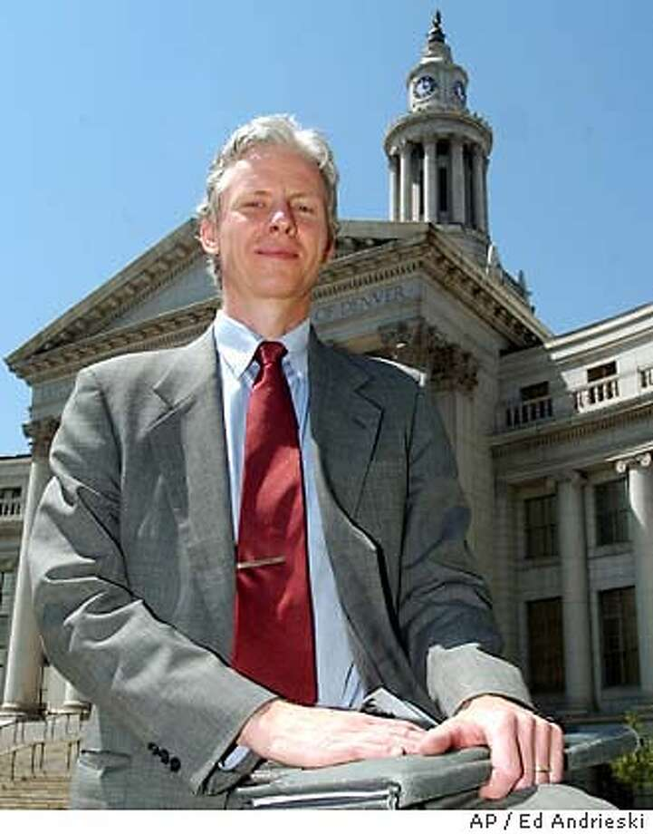 Jeff Peckman stands in front of the Denver City and County Building, Friday, Aug. 15, 2003. Peckman, a fromer transcendental meditation teacher, wants the Denver City Council to reduce stress, and gathered enough signatures to put the proposal on the November ballot. Across the country, state and local ballots on Nov. 4 will include an eclectic array of propositions _ dealing with gay rights, mass transit and economic development, among other topics. (AP Photo/Ed Andrieski) Photo: ED ANDRIESKI