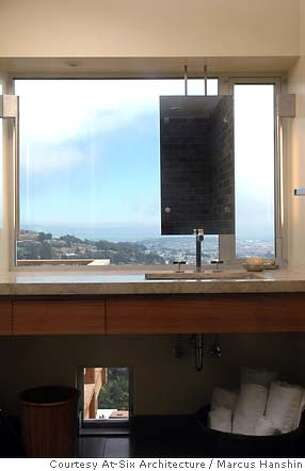 the remodeled bath looks at the view with a mirror suspended in front of the window, San Francisco, by @6 architecture Photo: Handout
