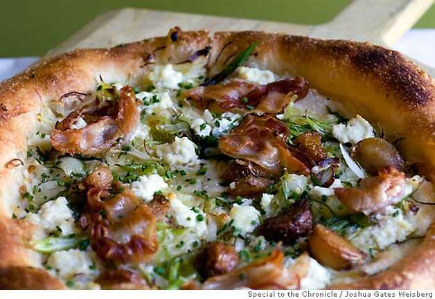 "43298 - LA_RESTAURANTS25 - ""Coach Farm Goat Cheese, Leeks, Scallions and Bacon Pizza"" ($14) at Pizzeria Mozza in Hollywood, California on July 14, 2007. By JOSHUA GATES WEISBERG/SPECIAL TO THE CHRONICLE Photo: JOSHUA GATES WEISBERG"