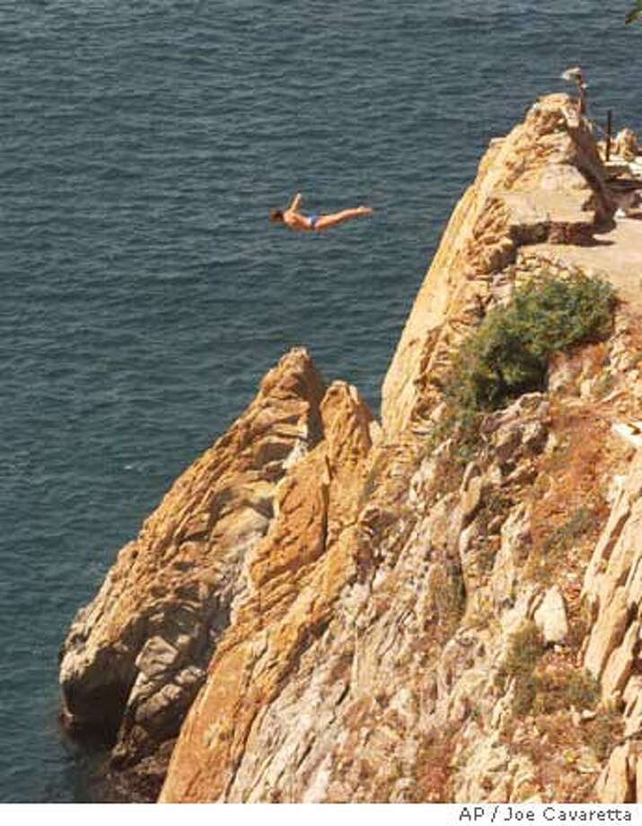A diver appears to fly off the La Quebrada cliff in Acapulco during an international competition. Associated Press photo by Joe Cavaretta