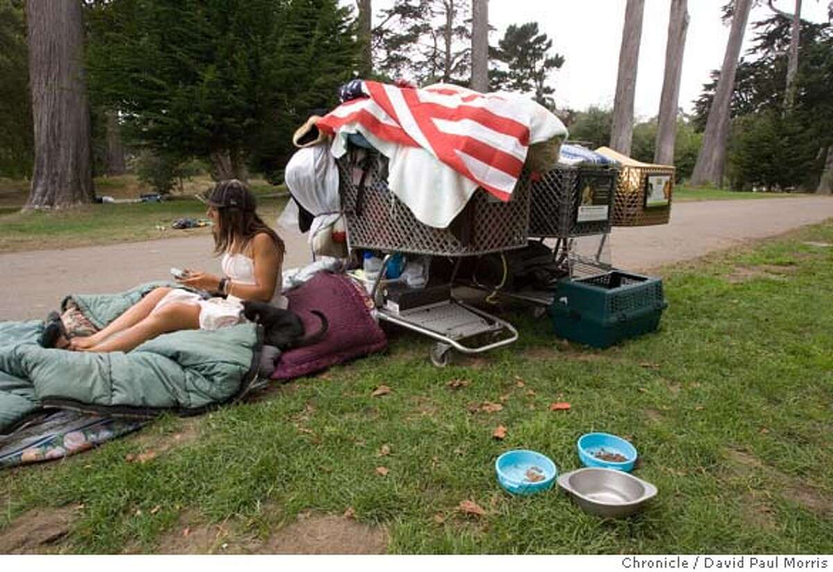 SAN FRANCISCO, CA - JULY 24: Homeless camper Eve Malloy sits with her kitten in Golden Gate Park on July 24, 2007 San Francisco, California. (Photo by David Paul Morris/ The Chronicle)