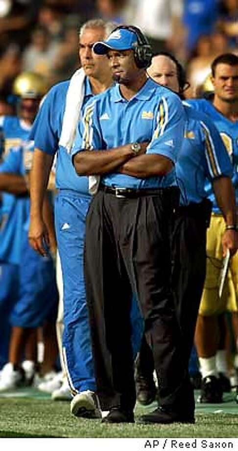 UCLA head coach Karl Dorrell watches the game against Washington in the second quarter at the Rose Bowl in Pasadena, Calif., Saturday, Oct. 4, 2003. UCLA upset No. 18 Washington, 46-16. (AP Photo/Reed Saxon) Photo caption  sportssky15_ph21065139200APUCLA head coach Karl Dorrell watches the game against Washington in the second quarter at the Rose Bowl in Pasadena, Calif., Saturday, Oct. 4, 2003. UCLA upset No. 18 Washington, 46-16. (AP Photo-Reed Saxon) Photo caption  sportssky15_ph21065139200APUCLA head coach Karl Dorrell watches the game against Washington in the second quarter at the Rose Bowl in Pasadena, Calif., Saturday, Oct. 4, 2003. UCLA upset No. 18 Washington, 46-16. (AP Photo-Reed Saxon) Photo caption  sportssky15_ph21065139200APUCLA head coach Karl Dorrell watches the game against Washington in the second quarter at the Rose Bowl in Pasadena, Calif., Saturday, Oct. 4, 2003. UCLA upset No. 18 Washington, 46-16. (AP Photo-Reed Saxon) Photo caption  sportssky15_ph21065139200AP