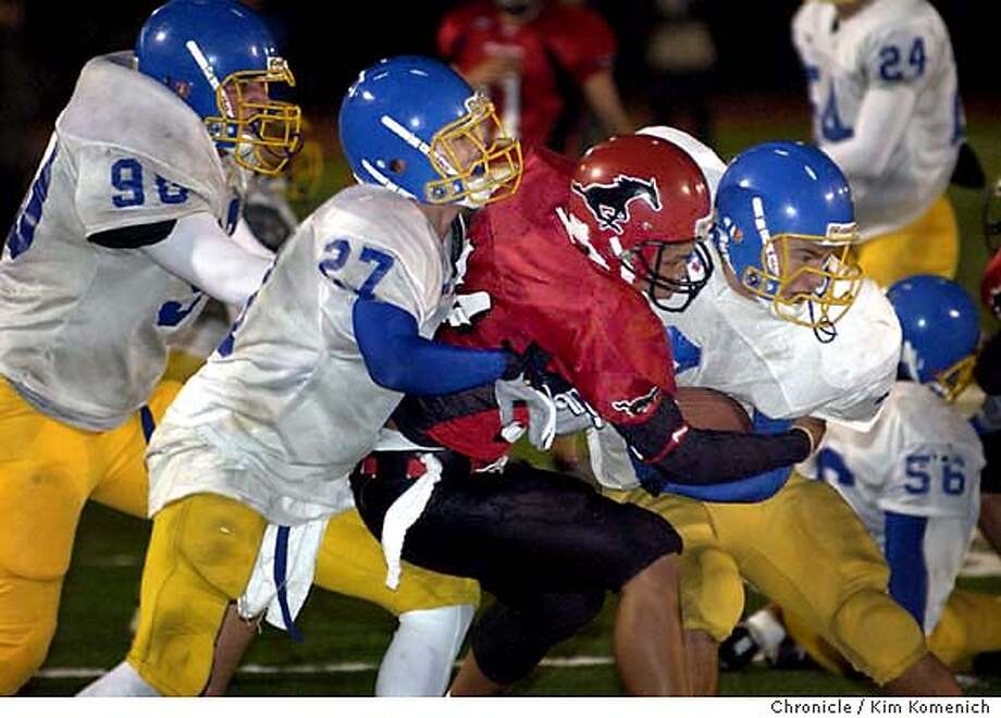 10/31/03 in Danville.  Foothill at Monte Vista High School Football in Danville. BOTH TEAMS ROSTERS HAVE MASSIVE ERRORS: I AM TIDYING SHIS UP AND WILL GET IT TO YOU BY PHONE>  Skyline defenders (90 TK), Jorge Gustavo(27) and Brandon Crawford (3) haul down Monte Vista (24 TK)  KIM KOMENICH / The Chronicle Photo: KIM KOMENICH