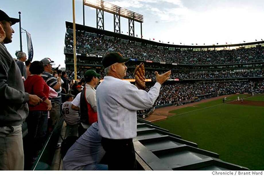 bonds24_scene_237.JPG  Scott Hylton from Sacramento applauded as Barry Bonds came to bat for the first time Monday night...Bonds walked.  AT&T Park got ready to host a seven game series Monday night that might see Barry Bonds catch or pass Hank Aaron's home run record.  {By Brant Ward/San Francisco Chronicle}7/23/07 Photo: Brant Ward