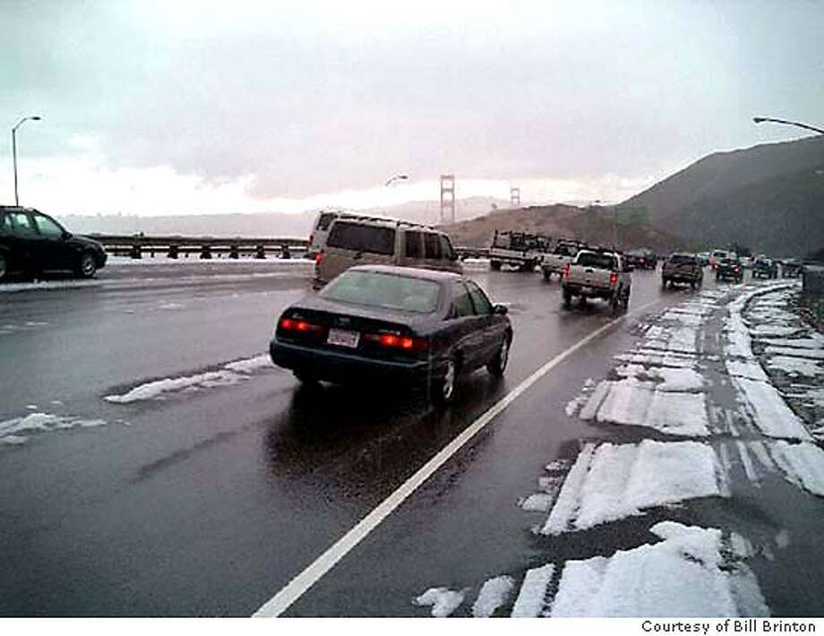 //note: emailed for better captions then below// Taken this morning at 11:05, Halloween, 10/31/03, minutes after a freak and unseasonable snowstorm hit the Waldo Grade just above the Golden Gate bridge. The photographer of the picture is a recent new Sonoman,living in Glen Ellen, who has, he claims, never seen snow on 101 at this elevation in the 55 years he has lived in San Francisco. //Photo credit to: Bill Brinton, Charles Creek Media. Local use in�SF Chron, no charge, other media, pay as per custom. Rights for a three time use are granted. Thanks, questions please call Bill at 415 517-4400 or email: bill@charlescreek.com Photo Courtesy of Bill Brinton, Charles Creek Media / The Chronicle Photo: Photo Courtesy Of Bill Brinton,