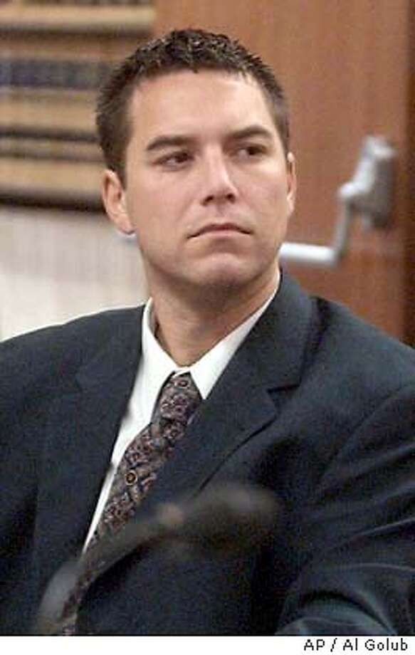 ** FILE ** Scott Peterson, who is accused of murdering his wife, Laci and the couple's unborn son, sits in court in this Sept. 2, 2003 file photo, in Modesto, Calif. A preliminary hearing to determine whether there is enough evidence to try Peterson on murder charges starts Wednesday, Oct. 29, 2003. (AP Photo/The Modesto Bee, Al Golub, File) POOL PHOTO, SEPT. 2, 2003 FILE PHOTO Scott Peterson is charged with murder in the deaths of his wife and their unborn son. ##Chronicle#10/30/2003####0421460936 Photo: AL GOLUB