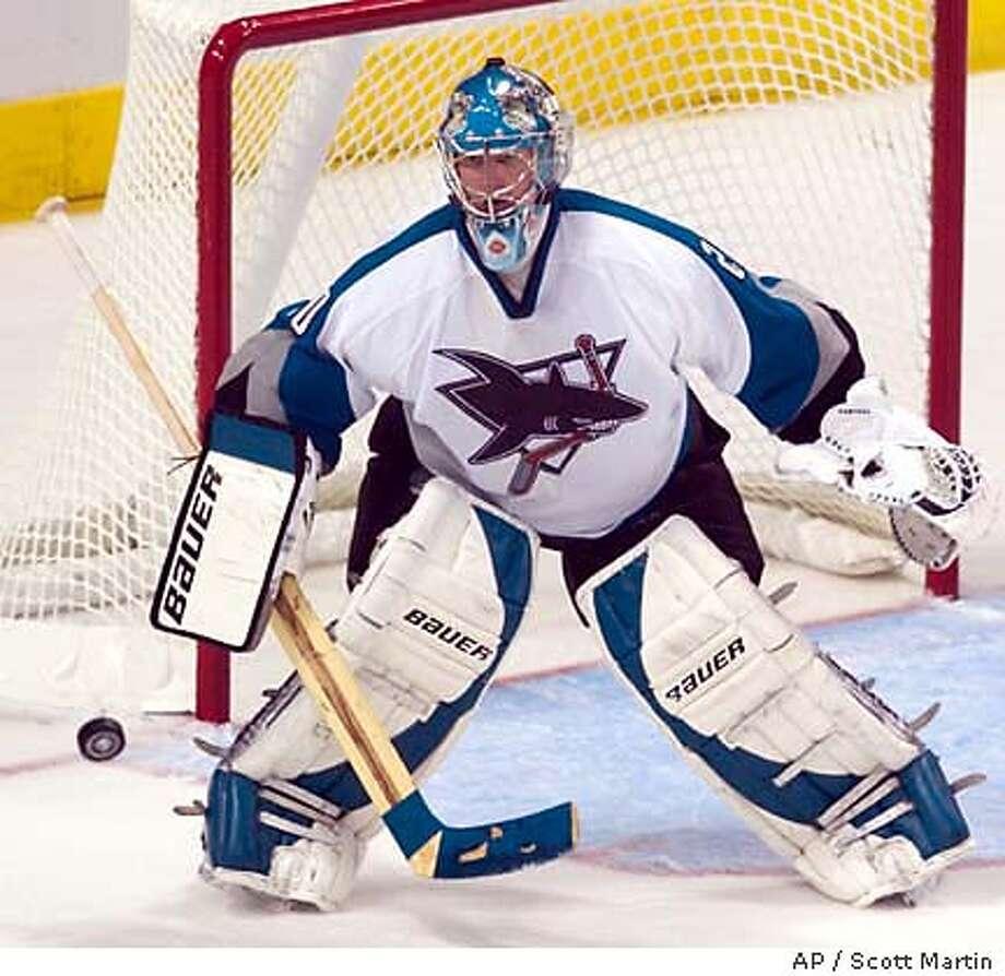 San Jose Sharks goalie Evgeni Nabokov, of Kazakhstan, blocks a shot from the Tampa Bay Lightning in overtime Thursday night, Oct. 30, 2003 in Tampa, Fla. The Sharks tied the Lightning, 2-2. (AP Photo/Scott Martin) Photo: SCOTT MARTIN
