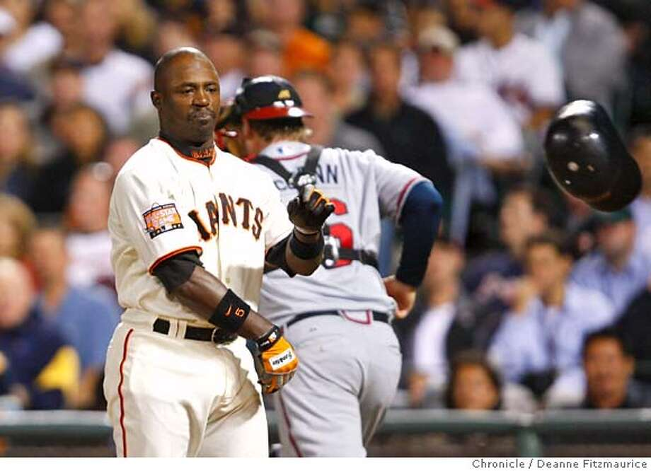 Ray Durham throws his helmet in frustration after striking out swinging to end the bottom of the fifth inning with men on first and in third.  Atlanta Braves play the San Francisco Giants at AT&T Park in San Francisco, CA, on Monday, July, 23 2007. photo taken: 07/23/2007  Deanne Fitzmaurice / The Chronicle ** (cq) Photo: Deanne Fitzmaurice
