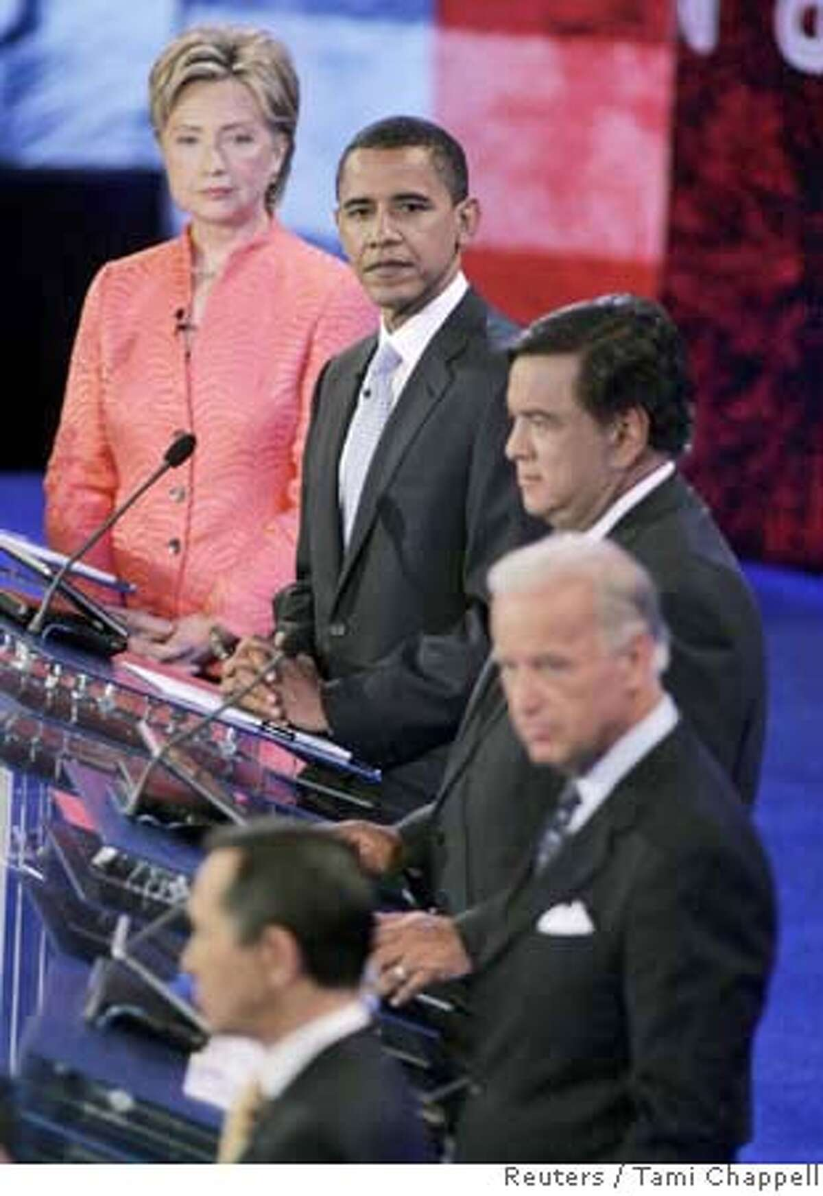 Democratic candidates listen during the CNN/YouTube democratic candidates debate in Charleston, South Carolina on the campus of The Citadel July 23, 2007. From (L-R) U.S. Senator Hillary Clinton (D-NY), U.S. Senator Barack Obama (D-IL), New Mexico Governor Bill Richardson, U.S. Senator Joe Biden (D-DE) and U.S. Congressman Dennis Kucinich (D-OH) (bottom). REUTERS/Tami Chappell (UNITED STATES)