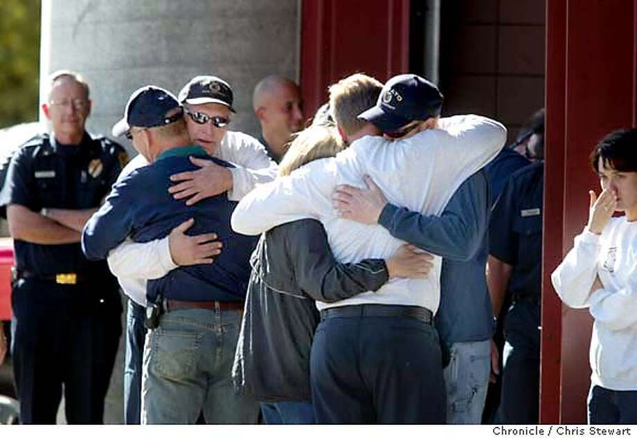 firefighter0128_cs.jpg Event on 10/30/03 in Novato. Novato Fire Protection District engineer Albert Curtiss (left, white sweatshirt) and Captain Jeff Beliquette (center, white sweatshirt) are hugged by family members and fellow firefighters as they returned today from Southern California fires to Novato Fire Protection District Station 1 after engineer Steven Rucker, 38, was killed and several others injured Wednesday while combating blazes in the massive San Diego County fires. Captain Doug McDonald, 48, engineer Shawn Kreps, 35, and firefighter-paramedic Barrett Smith, 28, suffered burns when they were overrun by the Cedar Fire. Fellow firefighters applauded as engine 6185 was backed into the station lot following a CHP escort and then took turns hugging the returning strike team. Chris Stewart / The Chronicle Jeff Veliquette, center, and Albert Curtiss, both in white sweatshirts, receive a warm welcome home. Photo: Chris Stewart