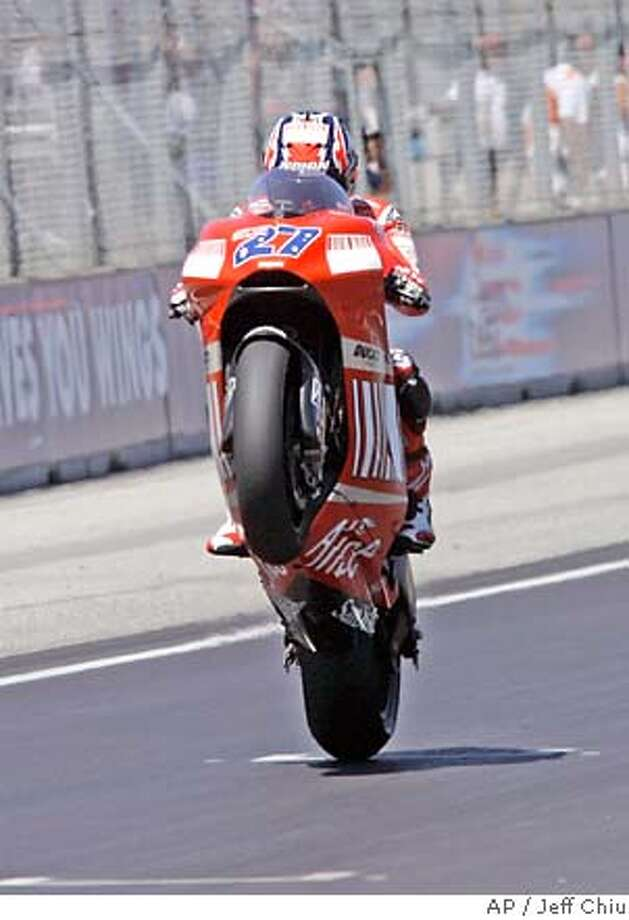 Australian Casey Stoner took a liking to the 11-turn track at Laguna Seca, and wheelied in as the first rider to win a MotoGP event this season from the pole position. Associated Press photo by Jeff Chiu