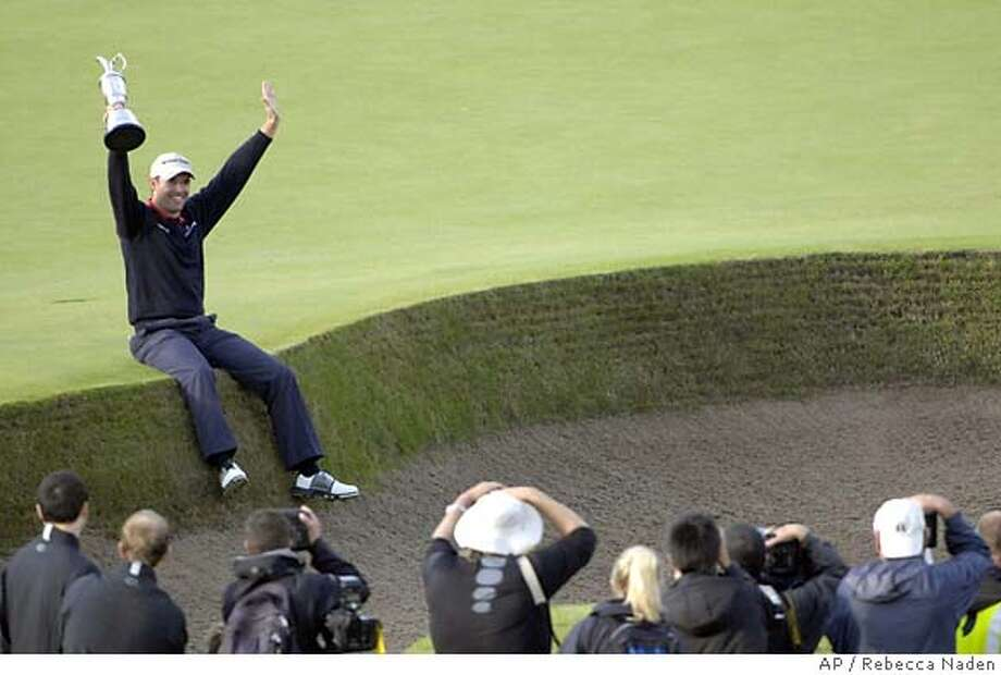 Ireland's Padraig Harrington poses for photographers holding the trophy after winning the British Open Golf Championship at Carnoustie, Scotland, Sunday July 22, 2007. (AP Photo/Rebecca Naden, POOL) ** EDITORIAL USE ONLY ** EDITORIAL USE ONLY Photo: Rebecca Naden