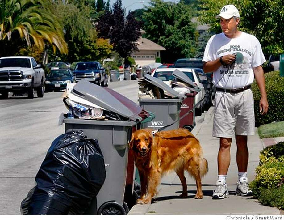 garbage_watch_223.JPG  Steve Argyres and his dog Abby stopped near their garbage on Columbia Street Sunday. Argyres says they have had little service since the strike started...he says the trucks get halfway up the Columbia Drive hill and then turn around.  The garbage strike was still not settled by 2pm Sunday....some residents of Castro Valley still hadn't had regular garbage service since the strike began.  {Brant Ward/San Francisco Chronicle}7/22/07 Photo: Brant Ward