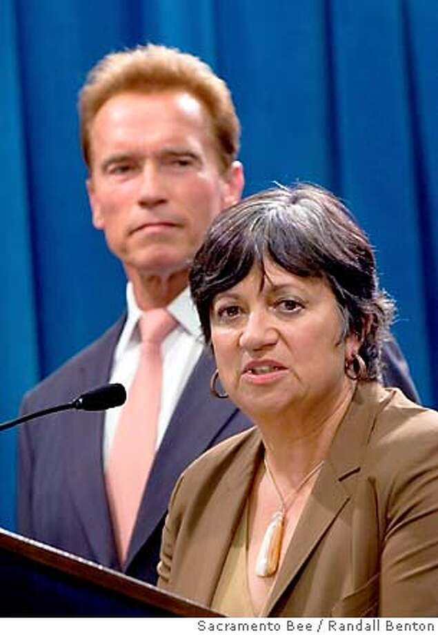 California Gov. Arnold Schwarzenegger, left, listens to Mary Nichols, newly-appointed chairwoman of the California Air Resources Board during a news conference at the California State Capitol in Sacramento, Calif., Tuesday, July 3, 2007. (AP Photo/Sacramento Bee, Randall Benton) ** MAGS OUT, TV OUT, INTERNET OUT, NO SALES ** MAGS OUT, TV OUT, INTERNET OUT, NO SALES Photo: Randall Benton