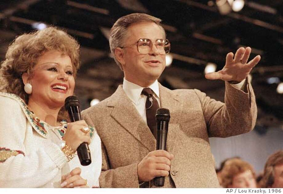 ** FILE **Tammy Faye Bakker and her then-husband, television evangelist Jim Bakker, talk to their TV audience iat their PTL ministry near Fort Mill, S.C., in this Aug. 20, 1986 file photo. Messner, who as Tammy Faye Bakker helped her husband, Jim, build a multimillion-dollar evangelism empire and then saw it collapse in disgrace, died Friday, July 20, 2007, said her booking agent, Joe Spotts. She was 65. (AP Photo/Lou Krasky, file) AUG. 20, 1986 FILE PHOTO Photo: Lou Krasky