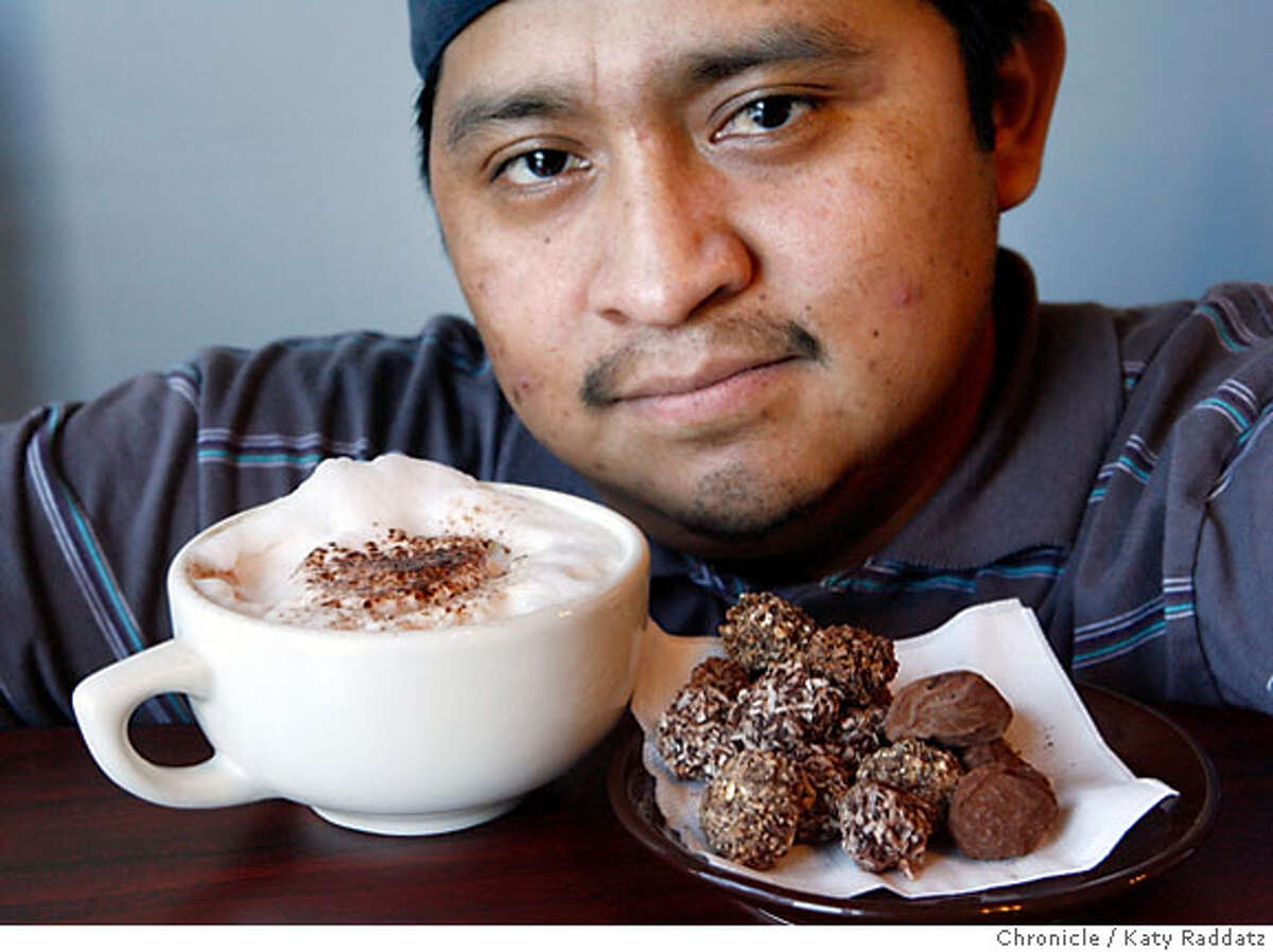 {filename SHOWN: Euan Santos, with cappucino and truffles, co-owner and chef at Five Star Truffles and Coffee at 411 Divisadero St. in San Francisco. For Bonnie Wach's Today's Special column. (Katy Raddatz/The Chronicle) **Euan Santos Mandatory credit for the photographer and the San Francisco Chronicle. No sales; mags out.