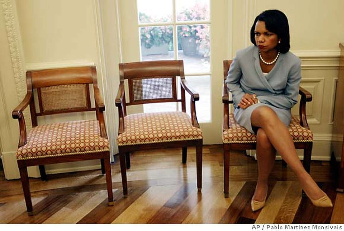 Secretary of State Condoleezza Rice, sits by herself in the Oval Office of the White House in Washington, Monday, July 16, 2007, during a meeting between President Bush and Polish President Lech Kaczynski. (AP Photo/Pablo Martinez Monsivais)