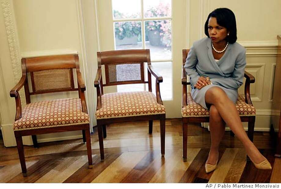 Secretary of State Condoleezza Rice, sits by herself in the Oval Office of the White House in Washington, Monday, July 16, 2007, during a meeting between President Bush and Polish President Lech Kaczynski. (AP Photo/Pablo Martinez Monsivais) Photo: Pablo Martinez Monsivais