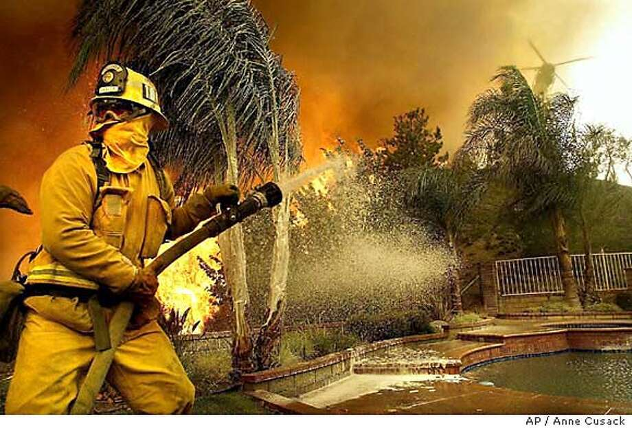BRUSH FIRE Photo: ANNE CUSACK